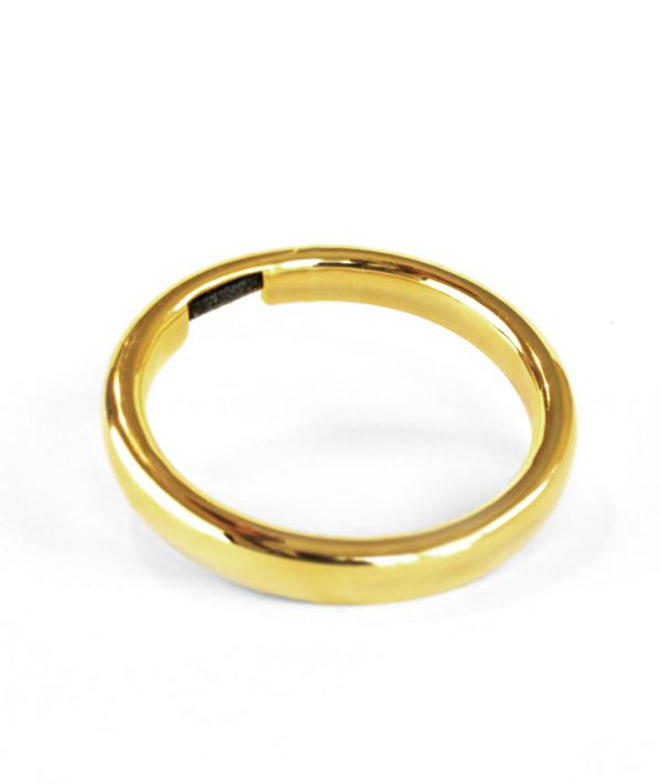 Bangle & Band 14K gold plated hair tie bracelet; this beautiful piece of jewelry features a small channel on the side of the bangle for the purpose of holding a hair tie.