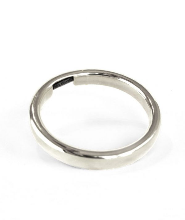 Bangle & Band silver-tone hair tie bracelet; this beautiful piece of jewelry features a small channel on the side of the bangle for the purpose of holding a hair tie.