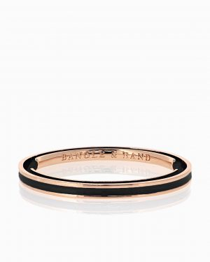 Rose gold hair tie bracelet with black enamel.